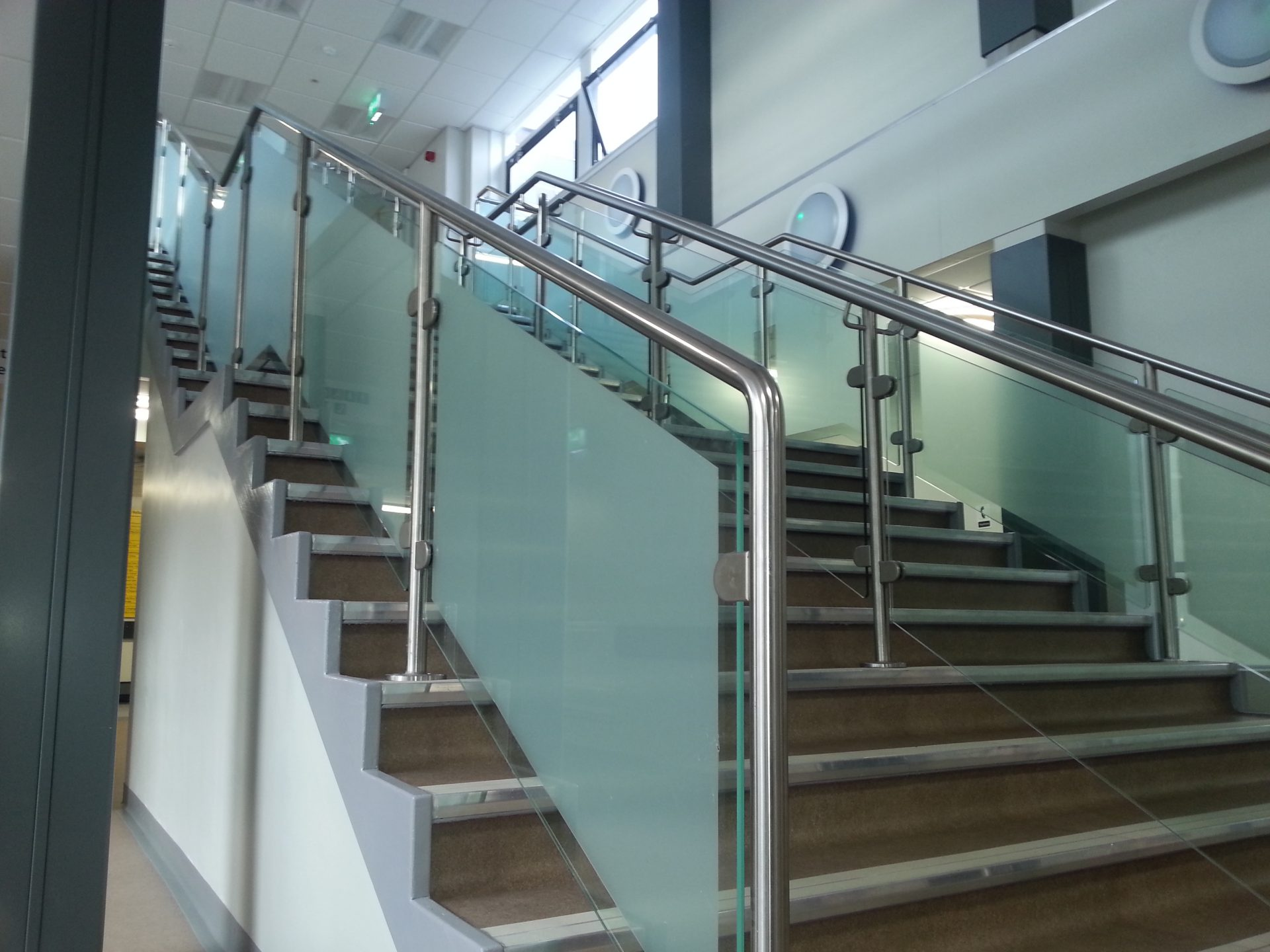 staircase metal handrails with glass between