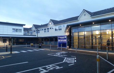 hospital main entrance blue haze evening