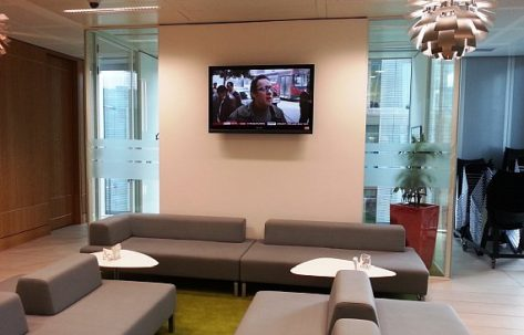 Office waiting room with tv on the wall