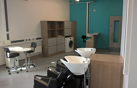 manchester-enterprise-academy-barber-studio-washing-machine-in-background